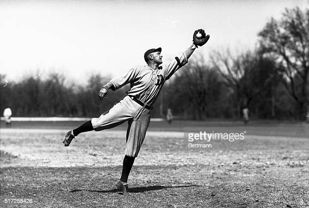 Ty Cobb outfielder with the Detroit Tigers seen making a fielding play during spring training