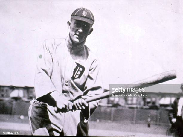 Ty Cobb poses during batting practice before a game in 1906 at Navin Field in Detroit, Michigan.