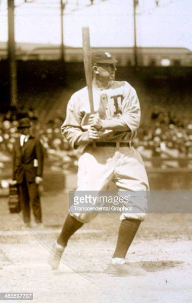 Ty Cobb raps out a hit in batting practice before a game in 1925 in Navin Field in Detroit, Michigan.
