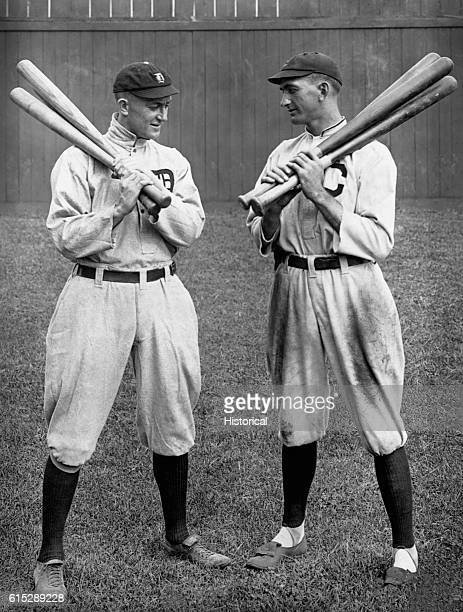 Ty Cobb the Georgia Peach stands with Shoeless Joe Jackson during a game between Cobb's Detroit Tigers and Jackson's team the Cleveland Indians