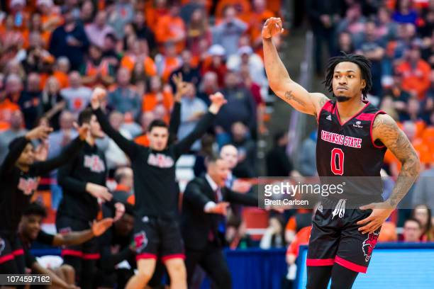 Ty Cockfield of the Arkansas State Red Wolves celebrates a three point basket during the first half against the Syracuse Orange at the Carrier Dome...