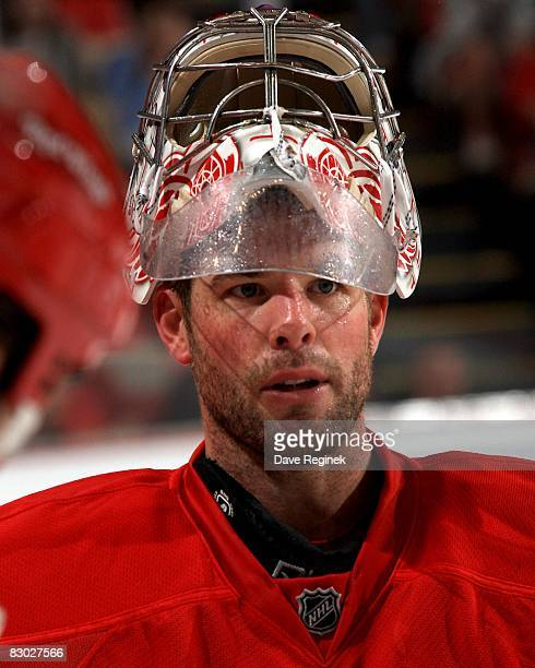 Ty Conklin of the Detroit Red Wings takes a short break during the NHL preseason opener against the Montreal Canadiens on September 24 2008 at Joe...