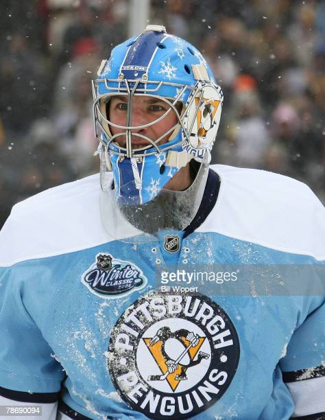 Ty Conklin of the Pittsburgh Penguins is covered with snow in their game against the Buffalo Sabres in the Amp Energy NHL Winter Classic on January 1...