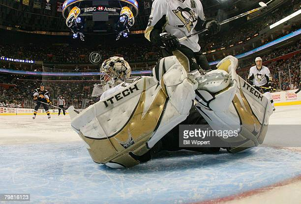 Ty Conklin of the Pittsburgh Penguins keeps his eyes on the puck as he dives to make a second period save against the Buffalo Sabres on February 17,...