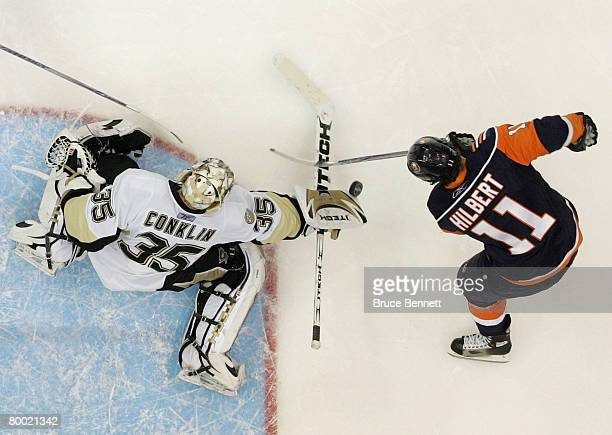 Ty Conklin of the Pittsburgh Penguins makes the stop on Andy Hilbert of the New York Islanders on February 26 2008 at the Nassau Coliseum in...