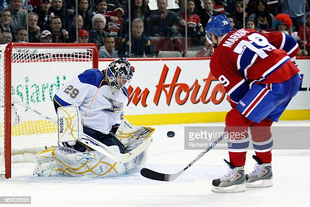 Ty Conklin of the St. Louis Blues stops the puck on a shot by Andrei Markov of the Montreal Canadiens during the overtime period of the NHL game on...