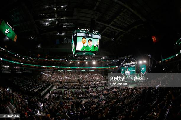 Ty Dellandrea poses after being selected thirteenth overall by the Dallas Stars during the first round of the 2018 NHL Draft at American Airlines...