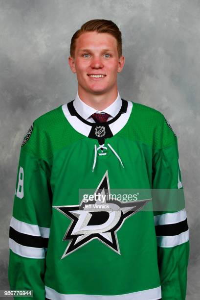 Ty Dellandrea poses for a portrait after being selected thirteenth overall by the Dallas Stars during the first round of the 2018 NHL Draft at...