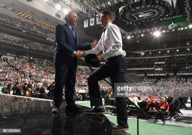 Ty Dellandrea shakes the hand of NHL Commissioiner Gary Bettman after being selected thirteenth overall by the Dallas Stars during the first round of...
