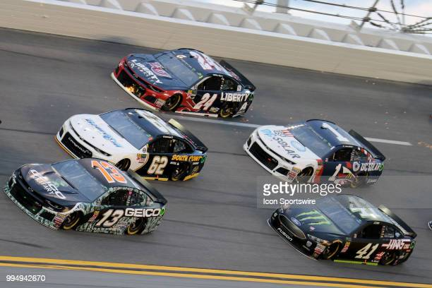 Ty Dillon Brendan Gaughan and William Byron go three wide during the Coke Zero 400 Monster Energy Cup Series race on July 7 at Daytona International...