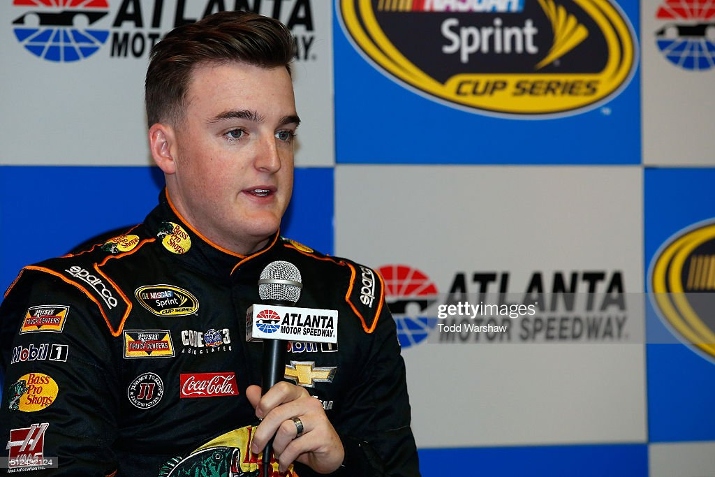 Ty Dillon, driver of the #14 Bass Pro Shops Tracker Boats Chevrolet, speaks with the media prior to practice for the NASCAR Sprint Cup Series Folds of Honor QuikTrip 500 at Atlanta Motor Speedway on February 26, 2016 in Hampton, Georgia.