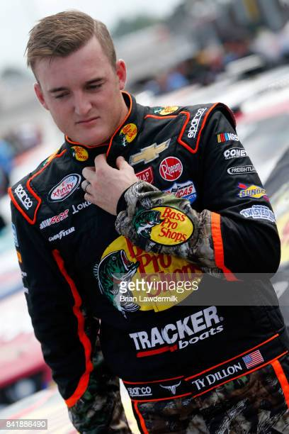 Ty Dillon driver of the Bass Pro Shops/Tracker Boats Chevrolet looks on during qualifying for the NASCAR XFINITY Series Sports Clips Haircuts VFW 200...