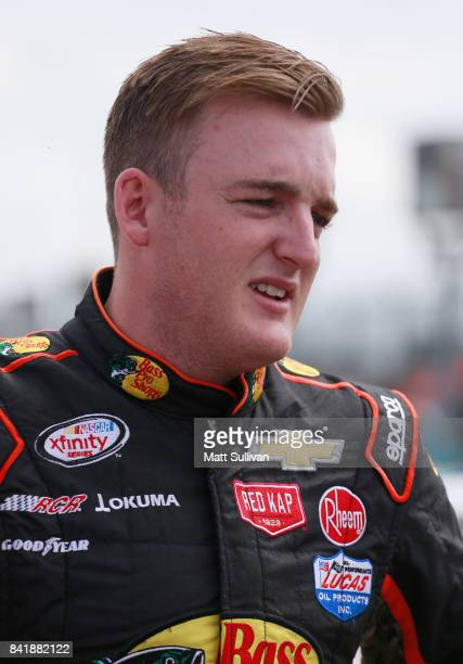 Ty Dillon driver of the Bass Pro Shops/Tracker Boats Chevrolet stands by his car prior to qualifying for the NASCAR XFINITY Series Sports Clips...