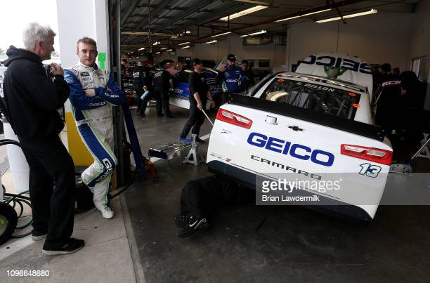 Ty Dillon driver of the GEICO Chevrolet stands in the garage area during practice for the Monster Energy NASCAR Cup Series 61st Annual Daytona 500 at...