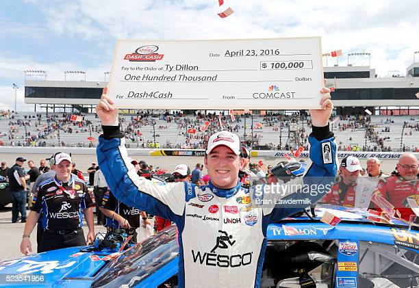 Ty Dillon driver of the WESCO Chevrolet celebrates after winning the Dash 4 Cash award after the NASCAR XFINITY Series ToyotaCare 250 at Richmond...