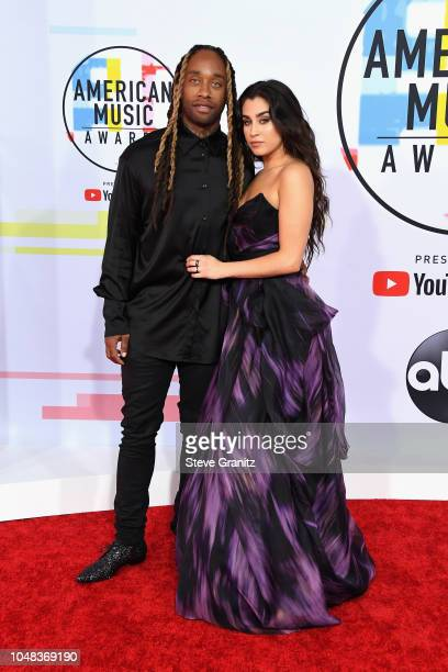 Ty Dolla Sign and Lauren Jauregui attend the 2018 American Music Awards at Microsoft Theater on October 9 2018 in Los Angeles California