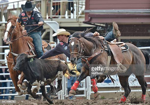 Ty Erickson from Helena MT, during Steer Wrestling competition, at the Calgary Stampede 2016. Twenty of the world's top competitors in each of the...