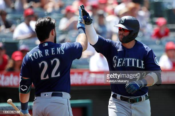 Ty France of the Seattle Mariners celebrates his three run home run with Luis Torrens during the fifth inning against the Los Angeles Angels at Angel...