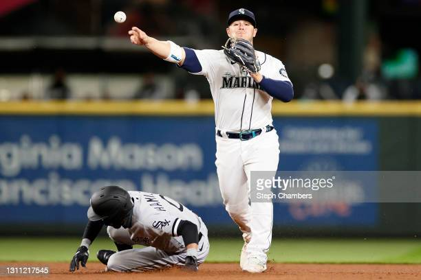 Ty France of the Seattle Mariners turns a double play over Billy Hamilton of the Chicago White Sox in the ninth inning at T-Mobile Park on April 06,...
