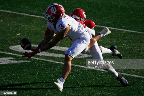 Ty Fryfogle of the Indiana Hoosiers can't haul in a reception against Christian Izien of the Rutgers Scarlet Knights during the first quarter at SHI...