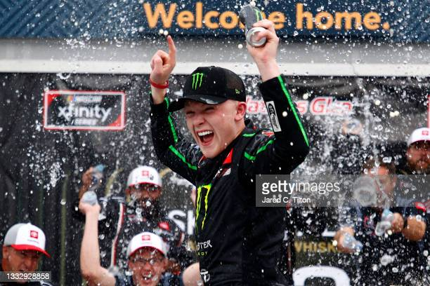 Ty Gibbs, driver of the Monster Energy Toyota, celebrates in the Ruoff Mortgage victory lane after winning the NASCAR Xfinity Series Skrewball Peanut...