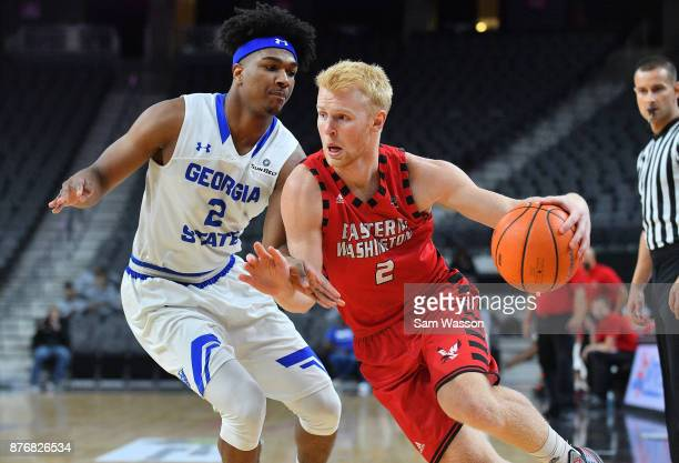 Ty Gibson of the Eastern Washington Eagles drives against Malik Benlevi of the Georgia State Panthers during day one of the Main Event basketball...