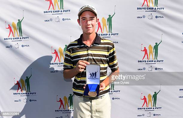 Ty Griggs poses with his medal after winning the Overall competition in the Boys 1213 yr old Drive Chip and Putt regional qualifying at Chambers Bay...