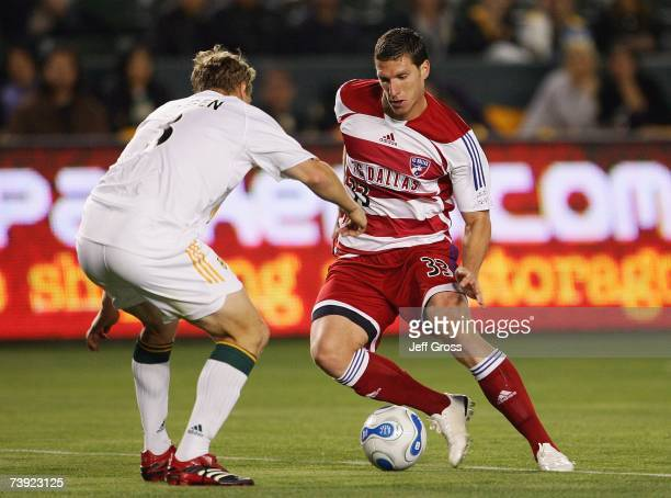 Ty Harden of the Los Angeles Galaxy defends Kenny Cooper of FC Dallas during their MLS match at The Home Depot Center on April 12 2007 in Carson...