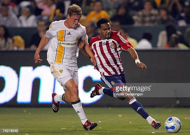 Ty Harden of the Los Angeles Galaxy defends Maykel Galindo of Chivas USA in the first half during their MLS match at Home Depot Center April 28 2007...