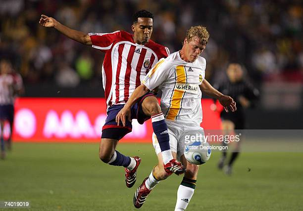Ty Harden of the Los Angeles Galaxy looks to protect the ball from Maykel Galindo of Chivas USA in the first half during their MLS match at Home...