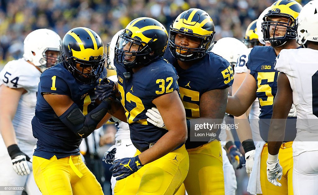 Ty Isaac #32 of the Michigan Wolverines celebrates a late fourth quarter touchdown with his teammates during the game against the Penn State Nittany Lions at Michigan Stadium on September 24, 2016 in Ann Arbor, Michigan. Michigan defeated Penn State 49-10.