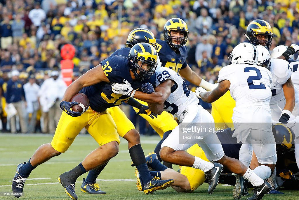 Ty Isaac #32 of the Michigan Wolverines runs the ball in for a fourth quarter touchdown during the game against the Penn State Nittany Lions at Michigan Stadium on September 24, 2016 in Ann Arbor, Michigan. Michigan defeated Penn State 49-10.