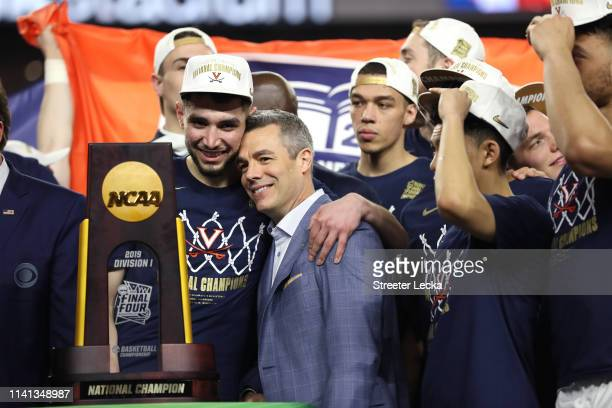 Ty Jerome and head coach Tony Bennett of the Virginia Cavaliers celebrate their teams 8577 win over the Texas Tech Red Raiders to win the the 2019...