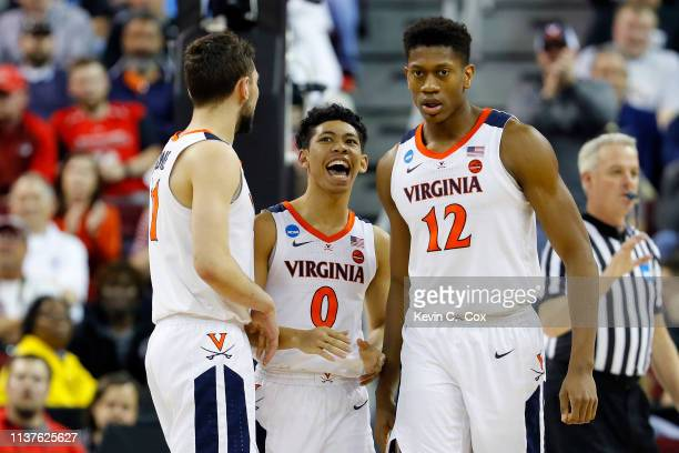 Ty Jerome Kihei Clark and De'Andre Hunter of the Virginia Cavaliers react after a play in teh second half against the Gardner Webb Runnin Bulldogs...