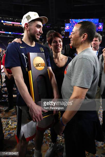 Ty Jerome of the Virginia Cavaliers celebrates with the trophy after his teams 8577 win over the Texas Tech Red Raiders to win the 2019 NCAA men's...