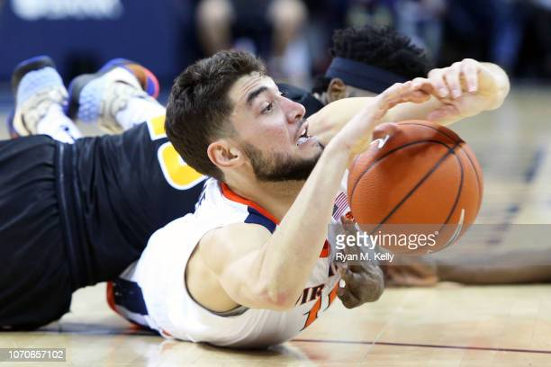 Ty Jerome of the Virginia Cavaliers dives for a loose ball in the second half during a game against the VCU Rams at John Paul Jones Arena on December...
