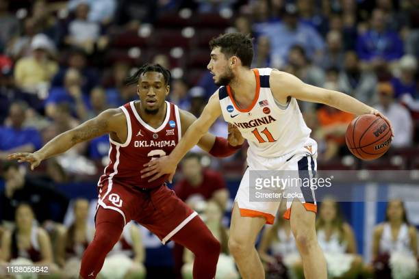Ty Jerome of the Virginia Cavaliers dribbles against Aaron Calixte of the Oklahoma Sooners during the first half in the second round game of the 2019...