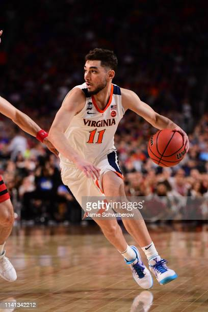 new product 2cebf 8893a Ty Jerome of the Virginia Cavaliers drives downcourt against the Texas Tech  Red Raiders during the. NCAA Men s Final Four ...