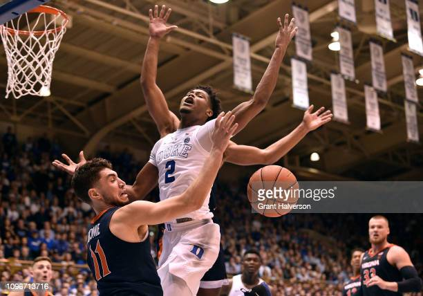 Ty Jerome of the Virginia Cavaliers fouls Cam Reddish of the Duke Blue Devils during the second half of their game at Cameron Indoor Stadium on...