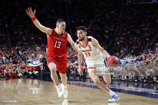 Ty Jerome of the Virginia Cavaliers is defended by Matt Mooney of the Texas Tech Red Raiders in the second half during the 2019 NCAA men's Final Four...