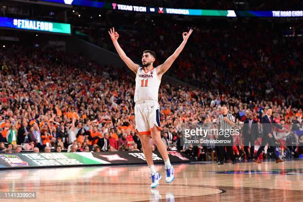 Ty Jerome of the Virginia Cavaliers reacts to a three pointer during the first half in the 2019 NCAA Photos via Getty Images men's Final Four...