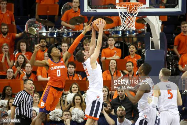Ty Jerome of the Virginia Cavaliers rebounds in front of Clyde Trapp of the Clemson Tigers in the second half during a game at John Paul Jones Arena...