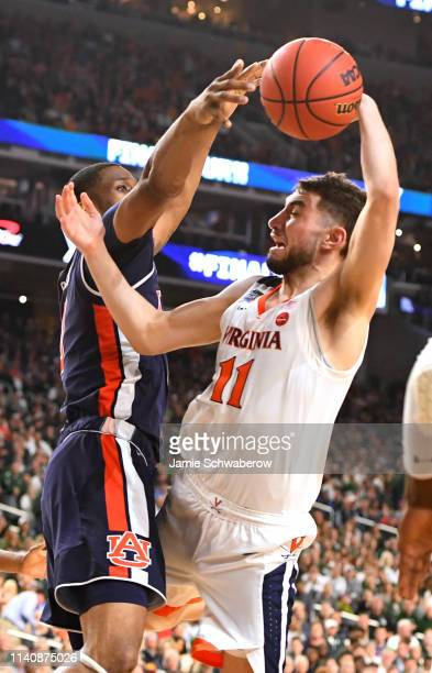 separation shoes cc066 a8aae Ty Jerome of the Virginia Cavaliers shoots against the Auburn Tigers of the  semifinal game in