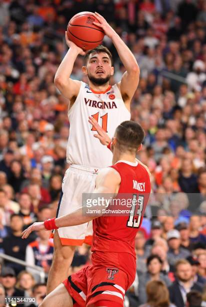 Ty Jerome of the Virginia Cavaliers shoots the ball over Matt Mooney of the Texas Tech Red Raiders during the second half of the 2019 NCAA men's...