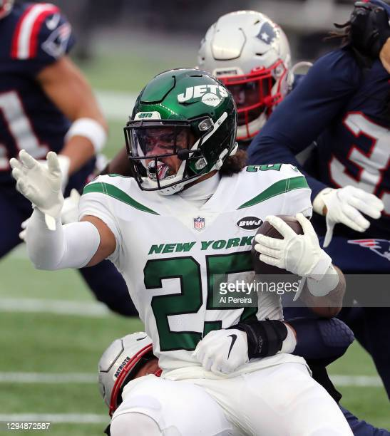 Ty Johnson of the New York Jets has a long gain against the New England Patriots at Gillette Stadium on January 3, 2021 in Foxborough, Massachusetts.