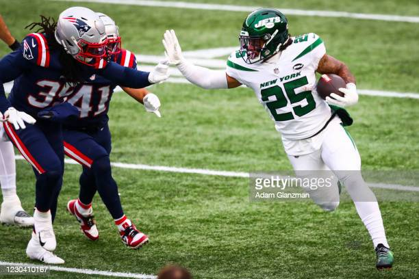 Ty Johnson of the New York Jets runs with the ball during a game against the New England Patriots at Gillette Stadium on January 3, 2021 in...