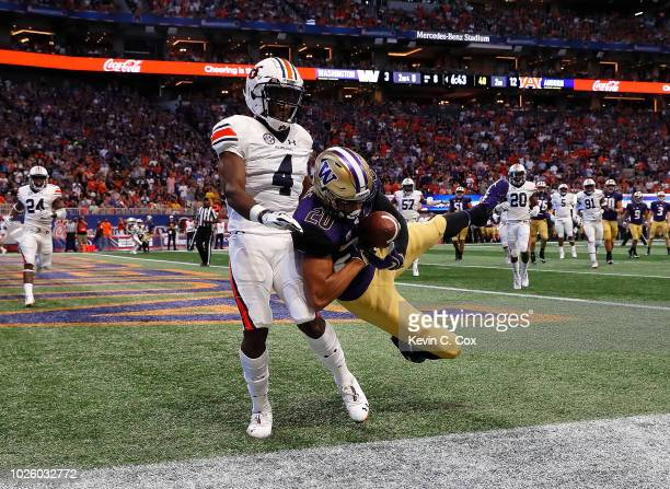 Ty Jones of the Washington Huskies fails to pull in this touchdown reception against Noah Igbinoghene of the Auburn Tigers at MercedesBenz Stadium on...
