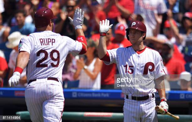 Ty Kelly of the Philadelphia Phillies congratulates teammate Cameron Rupp on a home run in the second inning against the San Diego Padres at Citizens...