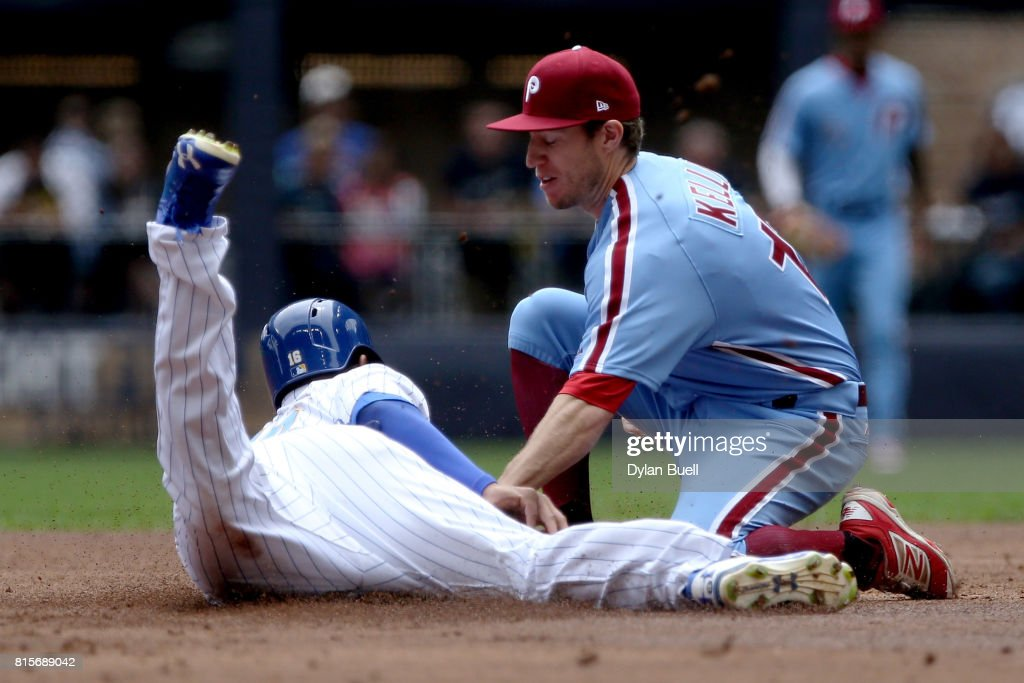 Ty Kelly #15 of the Philadelphia Phillies tags out Domingo Santana #16 of the Milwaukee Brewers at second base in the first inning at Miller Park on July 16, 2017 in Milwaukee, Wisconsin.