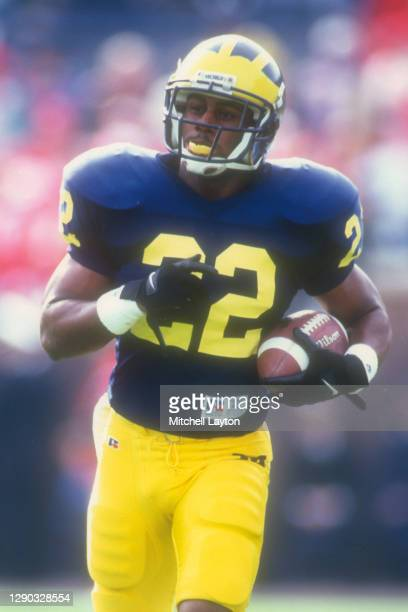 Ty Law of the Michigan Wolverines runs with the ball during a college football game against the Wisconsin Badgers on October 29, 1994 at Michigan...